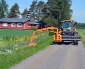 Wille 865 with Boom Flail Mower cutting road side.
