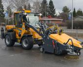 Wille Optim Collecting sweeper 205 with Wille 365 cleaning a yard