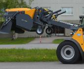 Wille Optim Collecting sweeper 650 with Wille 665 emptying the sweeper's debris storage