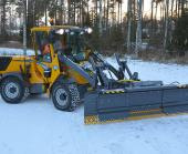 Wille Optim ZoomPlus 290 snow plow with Wille 465 outside, plowing width maximized.